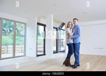 Portrait Of Happy Young Couple In New Home - Stock Photo