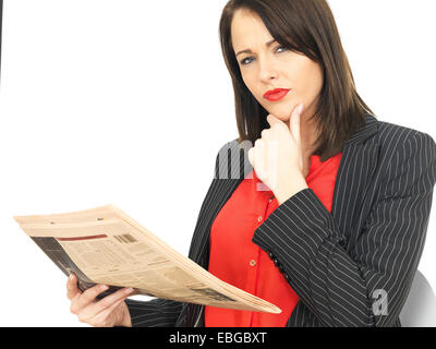 Attractive Business Woman Reading a Newspaper - Stock Photo
