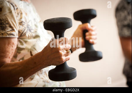 Senior woman with weights - Stock Photo