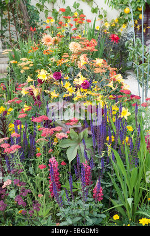 A Colourful Flower Border In A Cottage Garden Stock Photo