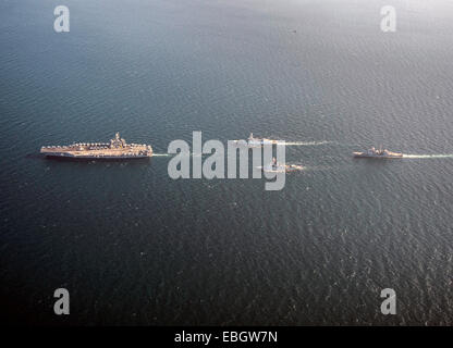 US Navy nuclear aircraft carrier USS Carl Vinson sails in formation with the Royal Navy Daring-class air defence - Stock Photo