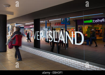 Burnley, Lancashire, UK, 1st December, 2014. 'River Island' reflections _Black Friday Weekend last day of discounted - Stock Photo