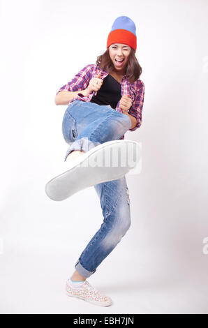 Teenage girl in torn jeans - Stock Photo