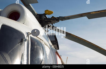 civil helicopter engine mechanism detail. part of copter propeller and cabin - Stock Photo