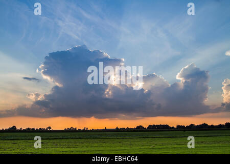 piled up Cumulonimbus cloud, from which rain falls, Germany, Bavaria - Stock Photo
