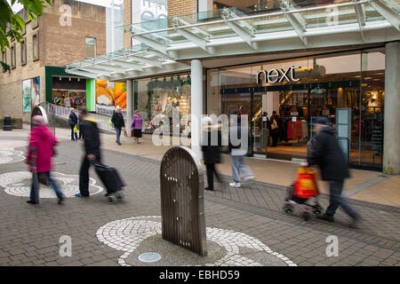 Burnley, Lancashire, UK, 1st December, 2014. 'Next' in Curzon Street_ Black Friday Weekend last day of discounted - Stock Photo