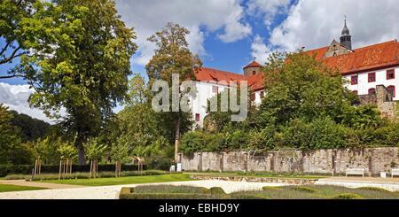 knot garden with castle and cloister Iburg, Germany, North Rhine-Westphalia, Muensterland, Bad Iburg - Stock Photo