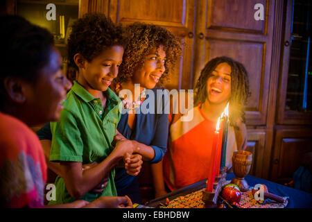 Family celebrating Kwanzaa - Stock Photo