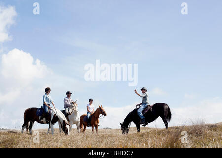 Horse riding, Pakiri Beach, Auckland, New Zealand - Stock Photo