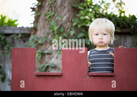 Young boy sulking - Stock Photo
