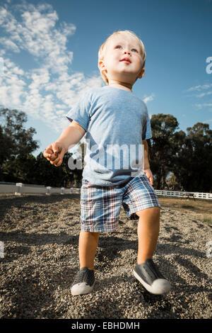 Young boy walking - Stock Photo