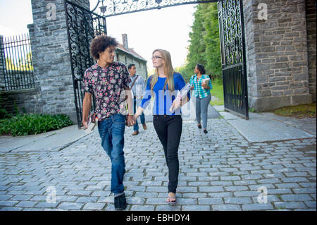 Students holding hands - Stock Photo