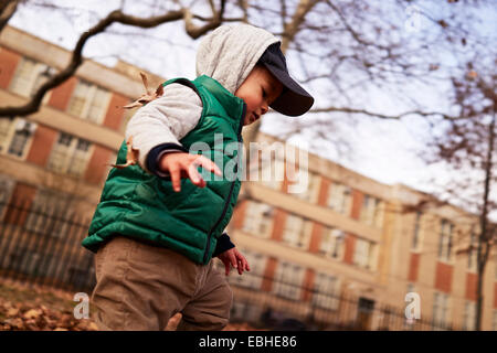 Boy playing in park, Brooklyn, New York, USA - Stock Photo