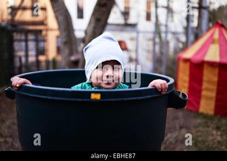 Boy inside tub, Brooklyn, New York, USA - Stock Photo
