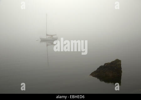 Sailboat on misty lake, Orcas Island, Washington State, USA - Stock Photo