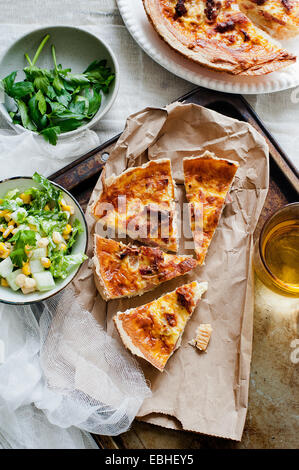 Quiche lorraine with parsley and salad - Stock Photo