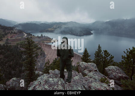 Man overlooking the Gross Dam in Colorado, USA - Stock Photo
