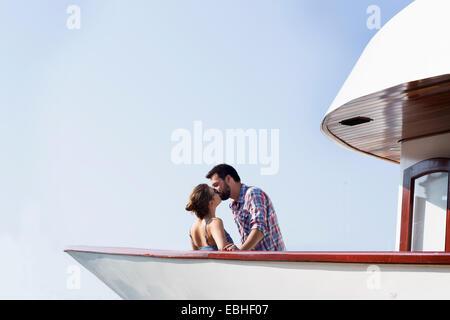 Young couple kissing on boat, Milna, Brac, Croatia - Stock Photo