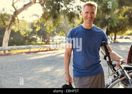 Portrait of mature male cyclist in park