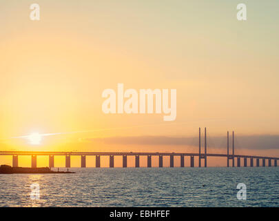 Sunset view of Oresund Bridge between Copenhagen, Denmark and Malmo, Sweden - Stock Photo