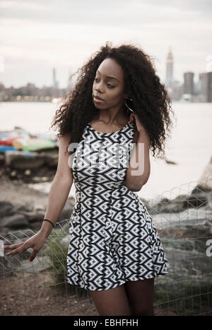Young woman wearing patterned dress - Stock Photo