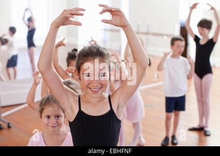 Portrait of girl ballet dancing in ballet school - Stock Photo