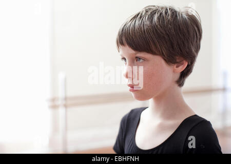 Portrait of sullen girl in ballet school - Stock Photo