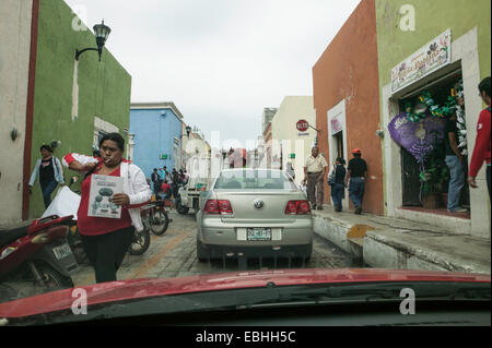 Traffic and crowded sidewalk with Mexican and Mayan people shopping in the historic city of Campeche, Mexico viewed - Stock Photo