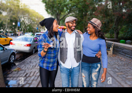 Friends on sidewalk - Stock Photo