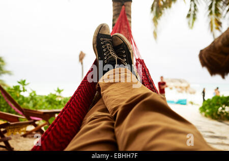 Mature mans self portrait of legs in beach hammock - Stock Photo