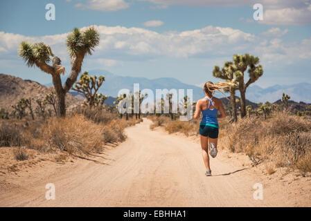 Woman running, Joshua Tree National Park, California, US