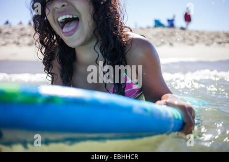 Close up of girl playing on bodyboard, Truro, Massachusetts, Cape Cod, USA - Stock Photo