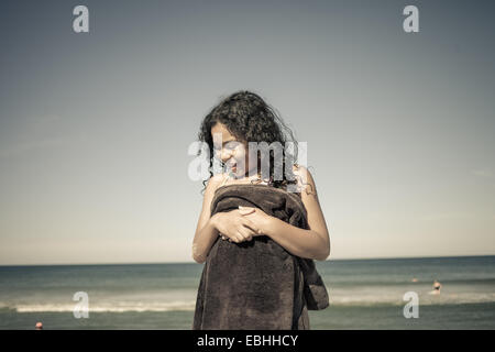 Girl wrapped in towel on beach, Truro, Massachusetts, Cape Cod, USA - Stock Photo