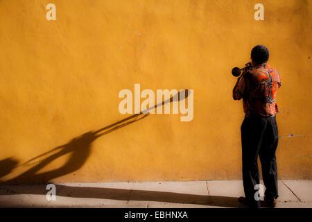 Man Playing Trumpet on Street, Old Town, Havana, Cuba - Stock Photo