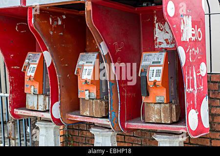 Public telephones with graffiti, Miri, Malaysia - Stock Photo
