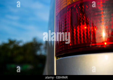 Teen girl and parked truck vehicle touching touch high-heeled shoe Stock Photo - Alamy