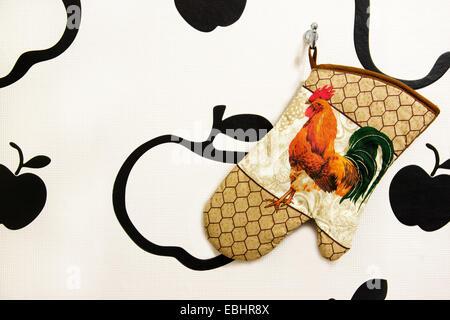 kitchen glove on the wall - Stock Photo