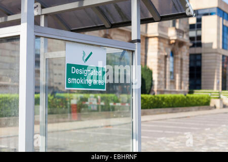 Designated Smoking Area shelter for smokers in the grounds of Belfast Harbour Commissioners Office - Stock Photo