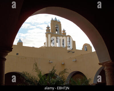 Iglesia de San Roque Church bells viewed from the beneath an arch in the courtyard of the Institute of Culture, - Stock Photo