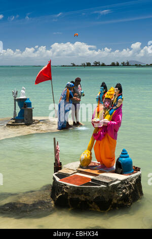Mauritius, Grand Gaube Sai Shakti Mandir temple, Hindu worshippers at Lord Narasimha seafront shrine - Stock Photo