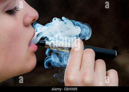 Closeup detail of Female with an Electronic Cigarette, Horizontal shot - Stock Photo