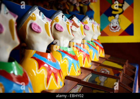 Ring Ball Toss Amusement Park Clowns - Stock Photo