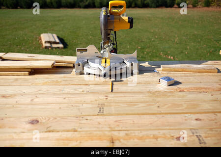 A miter saw, tape measure, pencil. - Stock Photo