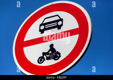 Road sign showing no entry for cars or motorcycles - Stock Photo