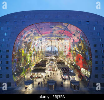 Market Hall Rotterdam, Rotterdam, Netherlands. Architect: MVRDV, 2014. View through illuminated market hall at dusk. - Stock Photo