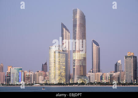 Skyline of modern buildings along Corniche waterfront in Abu Dhabi United Arab Emirates - Stock Photo