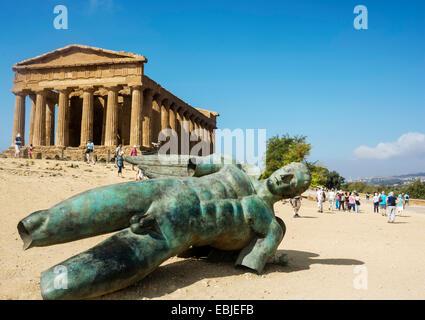 Agrigento. Sicily. Italy, Agrigento, Temple of Concordia & Fallen Ikarus sculpture by Igor Mitoraj - Stock Photo