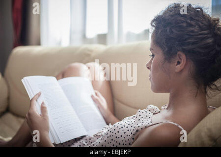 Young woman reading book - Stock Photo