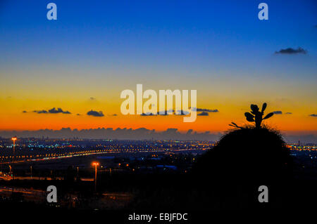 Sunset over Tel Aviv and Dan region in central Israel - Stock Photo