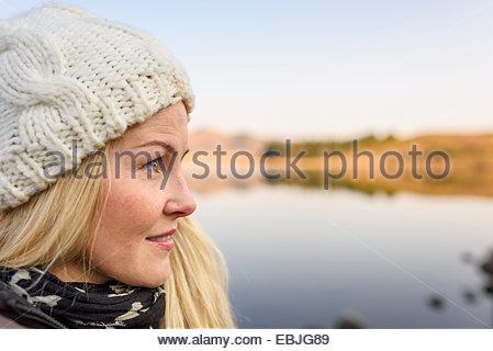 Woman by lake, Reykjavik, Iceland - Stock Photo